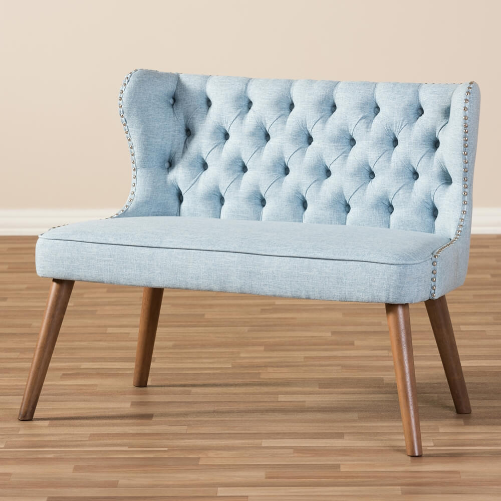 light blue loveseat tufted