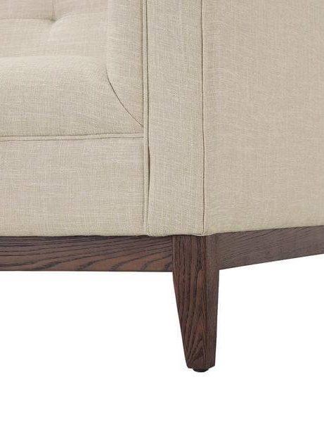 beige coop tufted sofa 461x600