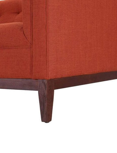 orange tufted sofa 461x600