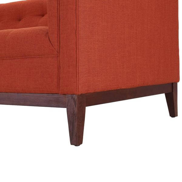orange tufted sofa